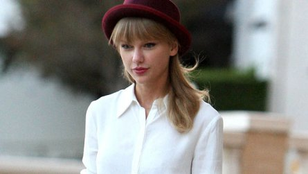 Taylor Swift rocking a white shirt with mulberry red bowlers hat